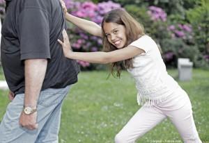 Girl pushing her grandpa