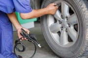 Man checking and filling the air on tire