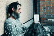 Homeless alcoholic in depression.