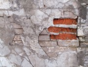 Rough and weathered old dirty brick wall