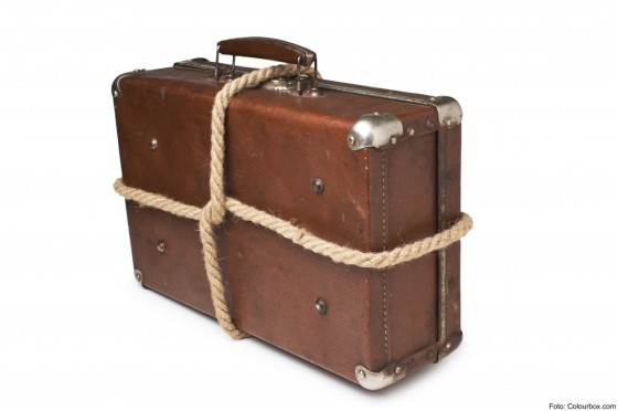 old suitcases tied with rope Isolated on white background