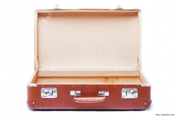 vintage brown suitcase - isolated over white background