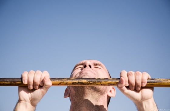 selective focus on face of man on blue sky background