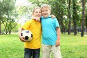 Boys in the summer park with a football ball