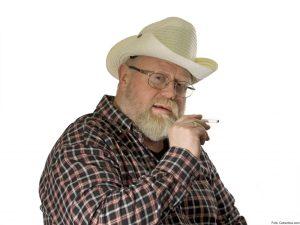 Smoking man on white background. Shot in studio.